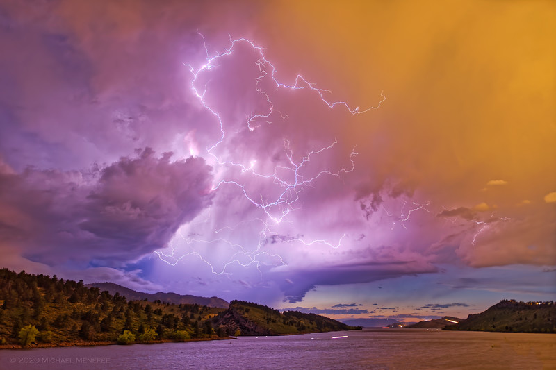 This was the starting salvo for a quickly evolving blue hour thunderstorm at Horsetooth Reservoir, CO just after the sun set.  The image is one minute of exposure time from two merged exposures and highlights some of the interesting cloud structure that was happening as the storm evolved quickly.
