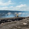 Geologist adjusts web cam at edge of Halema'uma'u.<br /> Access to this area is restricted <br /> Photo courtesy of USGS