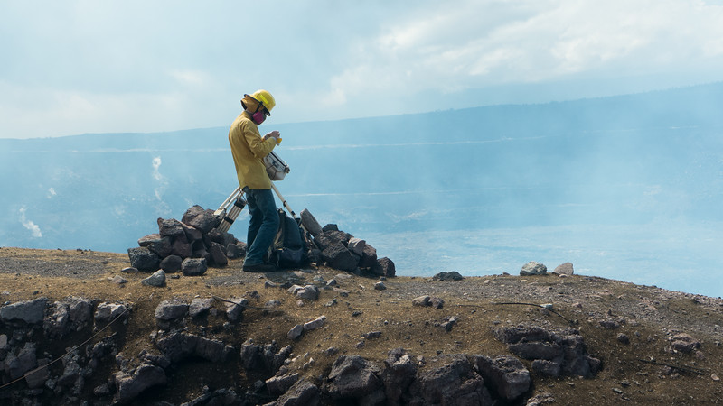 Geologist with range finder at edge of Halema'uma'u. Note Pele's Hair on ledge. <br /> Access to this area is restricted.<br /> Photo courtesy of USGS