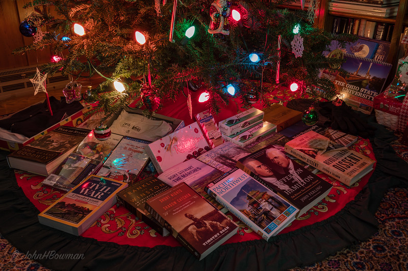 Opened Christmas gifts to us under tree on New Year's Eve (actuallya bit after midnight on January 1 - but camera still set for EDT, 1 hour ahead); used 35mm lens & polarizer; flash shots hand-held, time exposures used tripod