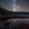 The Milky Way shines brightly over a remote lake in the mountains of West Virginia.