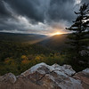 Beams of light burst through the dark storm clouds during sunset in the Dolly Sods Wilderness.