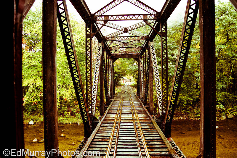 "Bridge Over Placid Water: I'm continuing with the train theme...This was shot from the back of a moving train - (""I got spoken to"" for hanging off of the back by the conductor. - As it turns out - the conductor is also a photographer so he understood that I didn't want to take that shot - I HAD to take that shot lol. THANK YOU SO MUCH for all of your comments on yesterday's locomotive shot!! And yes, it was moving towards me when I took the shot, fortunately for me I had the PERFECT vantage point from the back of the train!!!  10/03/2012"