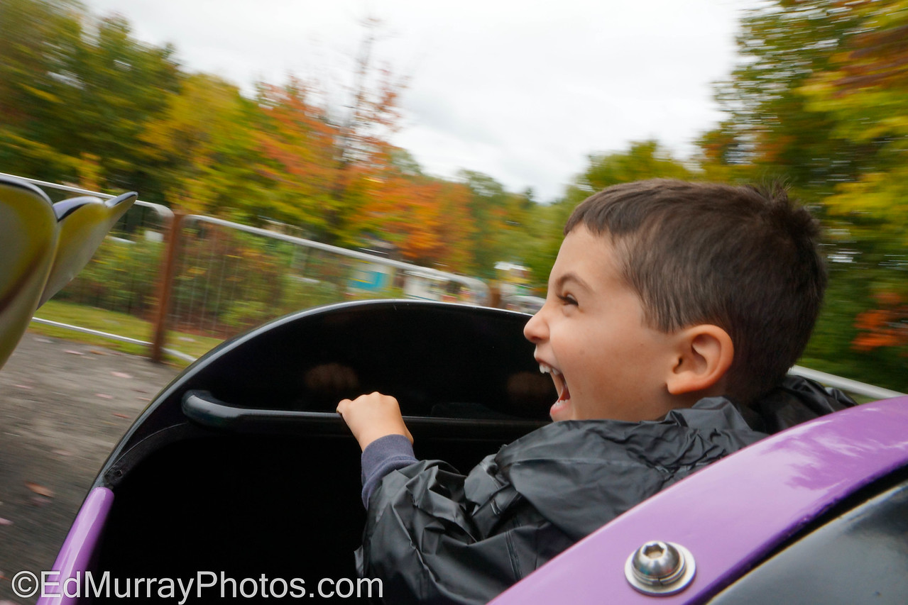 """Thrill Ride: Along with the train ride...we took the kids to """"Story Land"""" - It's a nursery rhyme and """"children's story"""" based  amusement park in New Hampshire's White Mountains. I decided to ride on the """"Flying Whales"""" with the boy. Obviously he had a blast.  10/04/2012"""