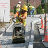 Employee's of Detour Construction out of Ludlow, MA work on putting in a new sidewalk at Northwest Elementary School in Leominster on Thursday morning. They have been putting in sideways at the schools all over the city. SENTINEL & ENTERPRISE/JOHN LOVE