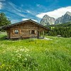 Rustic Hut and the Mountains, Seiser Alm in South Tyrol, Italy