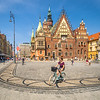 Cycling Past the Town Hall, Wrocław, Poland