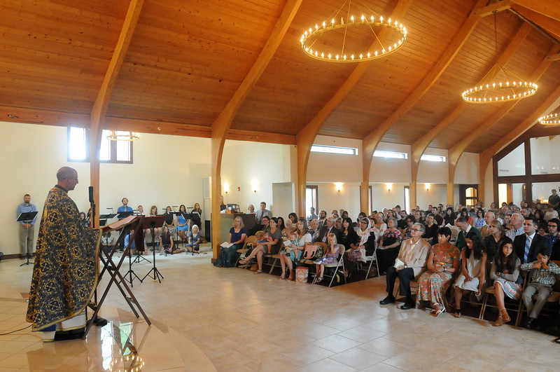 The Rev. Evan Armatas, priest of St. Spyridon Orthodox Church in Loveland, gives the homily to a nearly full house Sunday morning, Aug. 5, 2018, during the first divine liturgy in the newly renovated building. (Photo by Craig Young / Loveland Reporter-Herald)