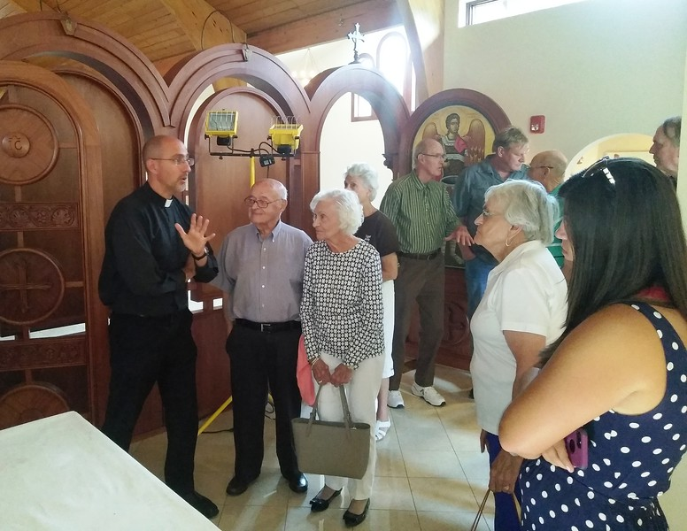 The Rev. Evan Armatas of St. Spyridon Orthodox Church, right, explains aspects of the new sanctuary Aug. 2 during one of the public tours of the church. The church held its first<br /> divine liturgy Aug. 5 in the new sanctuary. (Photo by Shelley Widhalm/ Special to the Loveland<br /> Reporter-Herald)