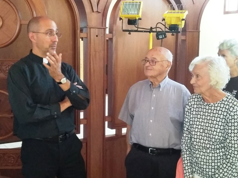 The Rev. Evan Armatas of St. Spyridon Orthodox Church, left, gives a tour Aug. 2 of the church's new sanctuary to about a dozen people, including Helen Harrison of Fort Collins, left, and her husband, Leon. The church held its first divine liturgy three days later in the new sanctuary.<br /> (Photo by Shelley Widhalm/ Special to the Loveland Reporter-Herald)