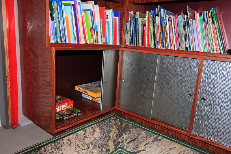 Base cabinet storage with sliding wavy metal doors