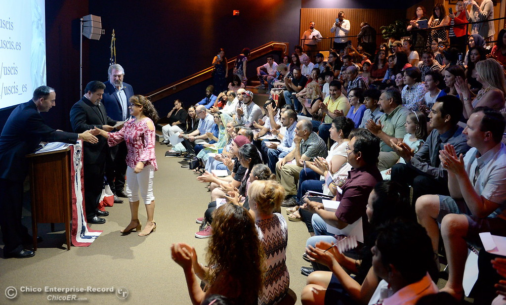 . A group of approximately 40 new U.S. citizens receive their certifications of citizenship during a ceremony at the Oroville Visitors Center in Oroville, Calif. Friday July 20, 2018. (Bill Husa -- Enterprise-Record)