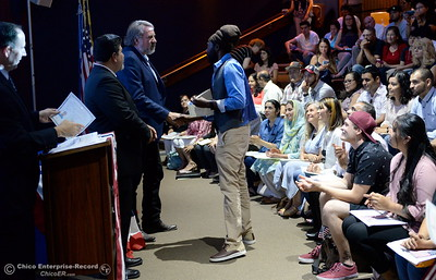 Congressman Doug LaMalfa shakes hands as a group of approximately 40 new U.S. citizens receive their certifications of citizenship during a ceremony at the Oroville Visitors Center in Oroville, Calif. Friday July 20, 2018. (Bill Husa -- Enterprise-Record)
