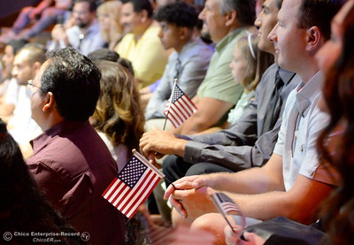 A group of approximately 40 new U.S. citizens receive their certifications of citizenship during a ceremony at the Oroville Visitors Center in Oroville, Calif. Friday July 20, 2018. (Bill Husa -- Enterprise-Record)