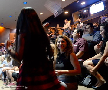 6-year-old Rose Karanizadeh waves a flag in excitement as her mother Marjan Kashefi smiles while a group of approximately 40 new U.S. citizens receive their certifications of citizenship during a ceremony at the Oroville Visitors Center in Oroville, Calif. Friday July 20, 2018. (Bill Husa -- Enterprise-Record)