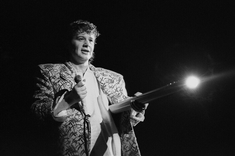 Jim Kerr performing live on stage with Simple Minds at Henry J. Kaiser Auditorium in Oakland on November 23, 1985.