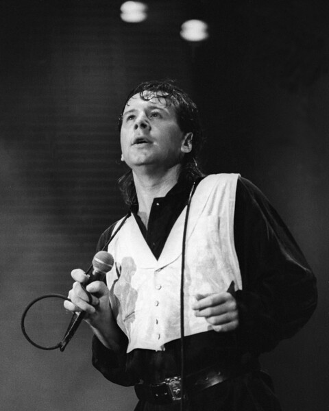 Jim Kerr performing live on stage with Simple Minds at the Greek Theater in Berkeley on April 26, 1986.