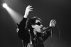 """Bono performing with U2 on the """"Zoo TV"""" tour at the Oakland Coliseum on April 17, 1992."""