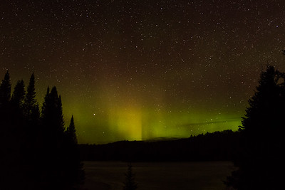 Northern Lights over frozen lake