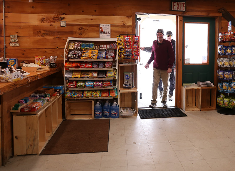 HOLLY PELCZYNSKI - BENNINGTON BANNER Jason Kratz of Greenfield MA and Jack Kene, of Pennsylvaniavisit the new Woodford General Store to check out the new interior while traveling through Vermont.