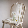 May 9 - Simple country decor<br /> <br /> I love the white daisies on the old white child's chair :)