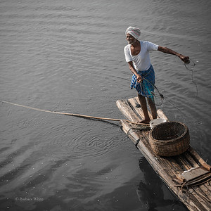 Fisherman Tossing Net