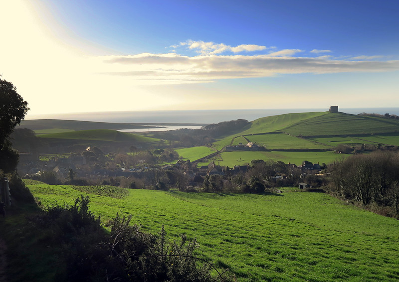 Looking back towards Abbotsbury with St Catherine's Chapel on the hill to the right.   The Fleet lagoon, thought to have existed for around 5000 years, is the body of water inland from the long shingle Chesil Beach, which began to be formed about 7000 years ago.