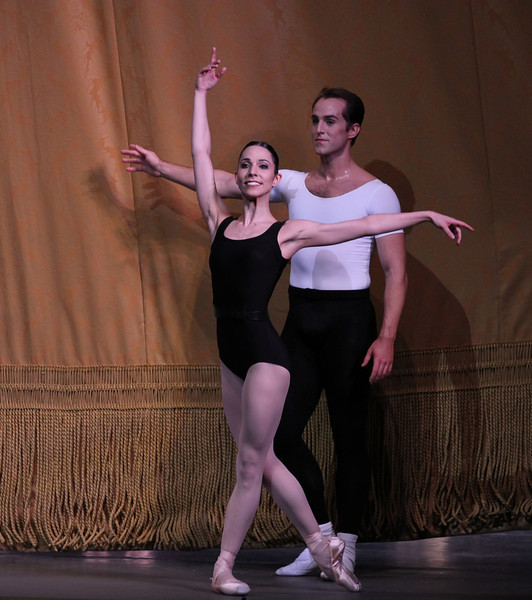 """Ana Sophia Scheller and Jared Angle, The Four Temperaments, October 4, 2013<br /> <br /> When going through my tickets for the New York City Ballet fall season a few weeks ago, I was at first disappointed to see that two of the performances were of the same program, Balanchine in Black & White. However, after seeing the performance last Saturday (see my review from September 29) filled with Balanchine's complexity and nuance, I valued the opportunity to see the program-consisting of The Four Temperaments, Episodes, Duo Concertant, and Symphony in Three Movements, again Friday night with a different cast.<br /> <br /> In The Four Temperaments, I particularly enjoyed Gonzalo Garcia in the Melancholic variation. His dancing flowed with the beautiful Paul Hindemith music as he displayed a substantial dramatic flair portraying a lost and anguished soul. His exit with an exaggerated arched back walking backwards was a dramatic conclusion.<br /> <br /> I also liked Ana Sophia Scheller in the Sanguinic variation with Jared Angle. She had a nice split jete section followed by turns that were well executed. Teresa Reichlen performed the Choleric variation, which was a bit more subdued relative to the frenetic energy provided by Ashley Bouder last Saturday. In one section that I enjoyed, Reichlen danced with four men. After the men had had enough of dancing with the choleric representation, they left the stage to be replaced by four women. The four women formed a square surrounding Reichlen. The four danced a short variation as Reichlen was frozen. The four dancers then paused as Reichlen danced a short variation in the middle of the square. They then danced in unison.<br /> <br /> In Episodes, Savannah Lowery and Amar Ramasar danced the """"spotlight"""" variation, Five Pieces, Opus 10 by Anton von Webern. They entered on opposite sides of a diagonal lit in spotlights as he was in all black while she was in an all white leotard. The pas de deux was dramatic and tense throughout, wi"""