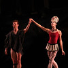 "Daniel Ulbricht and Maria Kowroski, Prodigal Son, October 11, 2013<br /> <br /> Balanchine's diversity and range were on display Friday night in The New York City Ballet All Balanchine Short Stories program. The three works ranged from La Sonnambula, a mysterious tale in the 19th century Romantic genre, Prodigal Son, a classic story of redemption and forgiveness from the bible, to Slaughter on Tenth Avenue, a fun, silly, fast moving Broadway piece about a stripper and tap dancer.<br /> <br /> Balanchine choreographed La Sonnambula in 1946 for Ballet Russe de Monte Carlo with music by Vittorio Rieti. New York City Ballet first performed it in 1960 with Allegra Kent and Erik Bruhn (Allegra was in the audience Friday evening). The ballet has 19th century era sets and costumes. The ballet opens with a regal party scene as the Poet (Robert Fairchild) joins the party. All eyes are on him as the host of the party, the Baron (Justine Peck) introduces him to the Coquette (Faye Arthurs). The Poet and Coquette flirt and dance, then sit and enjoy divertissements. The second divertissement was an interesting pas de deux with Lauren Lovette and Craig Hall, similar to the Act I Nutcracker Moore dance. It featured a section where Hall promenaded Lauren around while doing jetes. Troy Schumacher did a reasonable job as the Harlequin, which featured multiple split jumps; the solo had a sense of humor as in several sections in the solo, the Harlequin paused due to back pains, then recovered and resumed dancing. The solo ends with a horizontal dive off stage, hopefully a gentile landing on a gymnastics crash pad.<br /> <br /> The party resumes as the Coquette, dressed in a black gown, takes off her mask and dances romantically with the Poet. The Baron took the Coquette away as the party ended for dinner. The Poet was now a lost soul, searching for his new love. However, the Sleepwalker (Sterling Hyltin) bourreed into the scene holding a candle as if in a trance and the Poet was smitten by her. From the more detailed repertory notes available in the lobby, the Sleepwalker was the Baron's wife. The jealous Coquette saw the two in a romantic embrace and tells the Baron. He pulled a knife and stabbed the Poet. The Sleepwalker danced over his lifeless body and ultimately picked him up and carried him away. In the end, all eyes are on the balcony where the Sleepwalker took the Poet as the curtain closed. I agree with the repertory notes: ""The story remains mysterious, inviting different interpretations of the characters' actions and relationships.""<br /> <br /> I enjoyed the intense interaction between Fairchild and Sterling; Fairchild is mesmerized by the mysterious Sleepwalker as he tried to interrupt her trance. The two also did a nice job in Duo Concertant in the Black & White program.<br /> <br /> Next was Prodigal Son (1929) to music by Prokofiev. Serge Diaghilev, founder of Ballets Russes, hired Balanchine in 1924 and Prodigal son was Balanchine's last work for for the company's final Paris season. The story is derived from a biblical parable from the Gospel of Saint Luke. Russian poet, dancer and Diaghilev advisor Boris Kochno added dramatic material that emphasized the theme of sin and redemption.<br /> <br /> Daniel Ulbricht was the Prodigal Son, Maria Kowroski the Siren, and Jonathan Stafford the Father. Daniel opened with an energetic solo filled with high leaps and controlled multiple turns. He stomped around the stage opening his mouth wide as if to say, ""I am a spoiled brat."" The Father attempted to moderate his son's self-indulgent rant, but to no avail.<br /> <br /> Maria was the seductress Siren and she played this role well with her long, lean, imposing build that commands the stage. She has a long line with a never-ending extension. The Prodigal was gleeful upon discovering the Siren. She is taller than Daniel and he was like a little boy overpowered by her; he embraced her in a stomping promenade with his head buried against her chest as she raised her hand overhead as if to say, ""I have conquered him.""<br /> <br /> The Prodigal initially made friends with the grotesque-drinking companions that hideously stomped their way on stage. However, sensing danger, he tried to escape but was trapped by the strange bald creatures. They beat and striped the Prodigal bare and, as a final insult, the Siren stole his amulet. A single light focused on the bloody, near-naked Prodigal standing against a table, with everything taken from him. The pathetic stripped Prodigal crawled away for the long journey home.<br /> <br /> Using a wood pole to aid his crawl, the Prodigal finally arrived home. The father sees his battered son. In an iconic ballet moment with inspiring music of redemption, the father embraced his son and lifted him like a baby, protecting his son with his cape as he carried him home.<br /> <br /> Daniel excels at bravura steps like tours and pirouettes, but I wondered if he could pull off the dramatic part of this role. I thought his rendering was very good, particularly his return home and his shamed reaction when reunited with his father.<br /> <br /> In complete contrast to Prodigal Son, the comical Slaughter on Tenth Avenue ended the program. It was created for the 1936 Rodgers and Hart musical ""On Your Toes."" This was the first of four Rogers and Hart musicals Balanchine choreographed in the 1930s.<br /> <br /> According to the repertory notes, Slaughter is a parody of Broadway, Russian ballet, and the mob. It is a performance within a performance as it opens with a jealous Russian dancer (David Prottas) who hires a mobster to kill a rival during a new ballet. The new ballet is Slaughter on Tenth Avenue, about patrons of a sleazy strip joint near the waterfront in a rough area in New York City. The Hoofer (Andrew Veyette) falls in love with the Stripper (Sara Mearns). The Stripper is discovered with the Hoofer and the Big Boss (Justin Peck) accidentally shoots her. The actress Stripper somehow sends a note to the Hoofer to reveal the real murder plot. The Hoofer, aware that the thug (sitting in the real theatre balcony) will shoot him when he stops dancing, keeps repeating his last line until the police arrive.<br /> <br /> Sara Mearns was spectacular as the stripper. In a short black dress with string skirt, fishnet stockings, high heals, and blond hair flowing down to her shoulders, she paraded around the pink stage, hand on hip, strutting her stuff. Not typical fare at the ballet, but audience members (particularly the men) didn't seem to mind. Andrew Veyette as the Hoofer demonstrated his proficient tap dance abilities in several high-energy solos. I thought I had a long walk back home from Times Square-until I realized that I was at Lincoln Center."