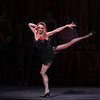 "Sara Mearns, Slaughter on Tenth Avenue, October 11, 2013<br /> <br /> Note: I don't take photos during the performances because it is distracting to other audience members. So how did I get this photo? Slaughter is a performance about events taking place in a performance. When bows took place for the performance within the performance, numerous audience members got up and tried to leave, thinking that it was over. It faked me out too and I thought this was part of the bows. The actual performance ended shortly after. <br /> <br /> Balanchine's diversity and range were on display Friday night in The New York City Ballet All Balanchine Short Stories program. The three works ranged from La Sonnambula, a mysterious tale in the 19th century Romantic genre, Prodigal Son, a classic story of redemption and forgiveness from the bible, to Slaughter on Tenth Avenue, a fun, silly, fast moving Broadway piece about a stripper and tap dancer.<br /> <br /> Balanchine choreographed La Sonnambula in 1946 for Ballet Russe de Monte Carlo with music by Vittorio Rieti. New York City Ballet first performed it in 1960 with Allegra Kent and Erik Bruhn (Allegra was in the audience Friday evening). The ballet has 19th century era sets and costumes. The ballet opens with a regal party scene as the Poet (Robert Fairchild) joins the party. All eyes are on him as the host of the party, the Baron (Justine Peck) introduces him to the Coquette (Faye Arthurs). The Poet and Coquette flirt and dance, then sit and enjoy divertissements. The second divertissement was an interesting pas de deux with Lauren Lovette and Craig Hall, similar to the Act I Nutcracker Moore dance. It featured a section where Hall promenaded Lauren around while doing jetes. Troy Schumacher did a reasonable job as the Harlequin, which featured multiple split jumps; the solo had a sense of humor as in several sections in the solo, the Harlequin paused due to back pains, then recovered and resumed dancing. The solo ends with a horizontal dive off stage, hopefully a gentile landing on a gymnastics crash pad.<br /> <br /> The party resumes as the Coquette, dressed in a black gown, takes off her mask and dances romantically with the Poet. The Baron took the Coquette away as the party ended for dinner. The Poet was now a lost soul, searching for his new love. However, the Sleepwalker (Sterling Hyltin) bourreed into the scene holding a candle as if in a trance and the Poet was smitten by her. From the more detailed repertory notes available in the lobby, the Sleepwalker was the Baron's wife. The jealous Coquette saw the two in a romantic embrace and tells the Baron. He pulled a knife and stabbed the Poet. The Sleepwalker danced over his lifeless body and ultimately picked him up and carried him away. In the end, all eyes are on the balcony where the Sleepwalker took the Poet as the curtain closed. I agree with the repertory notes: ""The story remains mysterious, inviting different interpretations of the characters' actions and relationships.""<br /> <br /> I enjoyed the intense interaction between Fairchild and Sterling; Fairchild is mesmerized by the mysterious Sleepwalker as he tried to interrupt her trance. The two also did a nice job in Duo Concertant in the Black & White program.<br /> <br /> Next was Prodigal Son (1929) to music by Prokofiev. Serge Diaghilev, founder of Ballets Russes, hired Balanchine in 1924 and Prodigal son was Balanchine's last work for for the company's final Paris season. The story is derived from a biblical parable from the Gospel of Saint Luke. Russian poet, dancer and Diaghilev advisor Boris Kochno added dramatic material that emphasized the theme of sin and redemption.<br /> <br /> Daniel Ulbricht was the Prodigal Son, Maria Kowroski the Siren, and Jonathan Stafford the Father. Daniel opened with an energetic solo filled with high leaps and controlled multiple turns. He stomped around the stage opening his mouth wide as if to say, ""I am a spoiled brat."" The Father attempted to moderate his son's self-indulgent rant, but to no avail.<br /> <br /> Maria was the seductress Siren and she played this role well with her long, lean, imposing build that commands the stage. She has a long line with a never-ending extension. The Prodigal was gleeful upon discovering the Siren. She is taller than Daniel and he was like a little boy overpowered by her; he embraced her in a stomping promenade with his head buried against her chest as she raised her hand overhead as if to say, ""I have conquered him.""<br /> <br /> The Prodigal initially made friends with the grotesque-drinking companions that hideously stomped their way on stage. However, sensing danger, he tried to escape but was trapped by the strange bald creatures. They beat and striped the Prodigal bare and, as a final insult, the Siren stole his amulet. A single light focused on the bloody, near-naked Prodigal standing against a table, with everything taken from him. The pathetic stripped Prodigal crawled away for the long journey home.<br /> <br /> Using a wood pole to aid his crawl, the Prodigal finally arrived home. The father sees his battered son. In an iconic ballet moment with inspiring music of redemption, the father embraced his son and lifted him like a baby, protecting his son with his cape as he carried him home.<br /> <br /> Daniel excels at bravura steps like tours and pirouettes, but I wondered if he could pull off the dramatic part of this role. I thought his rendering was very good, particularly his return home and his shamed reaction when reunited with his father.<br /> <br /> In complete contrast to Prodigal Son, the comical Slaughter on Tenth Avenue ended the program. It was created for the 1936 Rodgers and Hart musical ""On Your Toes."" This was the first of four Rogers and Hart musicals Balanchine choreographed in the 1930s.<br /> <br /> According to the repertory notes, Slaughter is a parody of Broadway, Russian ballet, and the mob. It is a performance within a performance as it opens with a jealous Russian dancer (David Prottas) who hires a mobster to kill a rival during a new ballet. The new ballet is Slaughter on Tenth Avenue, about patrons of a sleazy strip joint near the waterfront in a rough area in New York City. The Hoofer (Andrew Veyette) falls in love with the Stripper (Sara Mearns). The Stripper is discovered with the Hoofer and the Big Boss (Justin Peck) accidentally shoots her. The actress Stripper somehow sends a note to the Hoofer to reveal the real murder plot. The Hoofer, aware that the thug (sitting in the real theatre balcony) will shoot him when he stops dancing, keeps repeating his last line until the police arrive.<br /> <br /> Sara Mearns was spectacular as the stripper. In a short black dress with string skirt, fishnet stockings, high heals, and blond hair flowing down to her shoulders, she paraded around the pink stage, hand on hip, strutting her stuff. Not typical fare at the ballet, but audience members (particularly the men) didn't seem to mind. Andrew Veyette as the Hoofer demonstrated his proficient tap dance abilities in several high-energy solos. I thought I had a long walk back home from Times Square-until I realized that I was at Lincoln Center."