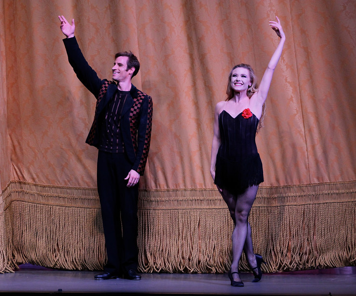 "Sara Mearns and Andrew Veyette, Slaughter on Tenth Avenue, October 11, 2013<br /> <br /> Balanchine's diversity and range were on display Friday night in The New York City Ballet All Balanchine Short Stories program. The three works ranged from La Sonnambula, a mysterious tale in the 19th century Romantic genre, Prodigal Son, a classic story of redemption and forgiveness from the bible, to Slaughter on Tenth Avenue, a fun, silly, fast moving Broadway piece about a stripper and tap dancer.<br /> <br /> Balanchine choreographed La Sonnambula in 1946 for Ballet Russe de Monte Carlo with music by Vittorio Rieti. New York City Ballet first performed it in 1960 with Allegra Kent and Erik Bruhn (Allegra was in the audience Friday evening). The ballet has 19th century era sets and costumes. The ballet opens with a regal party scene as the Poet (Robert Fairchild) joins the party. All eyes are on him as the host of the party, the Baron (Justine Peck) introduces him to the Coquette (Faye Arthurs). The Poet and Coquette flirt and dance, then sit and enjoy divertissements. The second divertissement was an interesting pas de deux with Lauren Lovette and Craig Hall, similar to the Act I Nutcracker Moore dance. It featured a section where Hall promenaded Lauren around while doing jetes. Troy Schumacher did a reasonable job as the Harlequin, which featured multiple split jumps; the solo had a sense of humor as in several sections in the solo, the Harlequin paused due to back pains, then recovered and resumed dancing. The solo ends with a horizontal dive off stage, hopefully a gentile landing on a gymnastics crash pad.<br /> <br /> The party resumes as the Coquette, dressed in a black gown, takes off her mask and dances romantically with the Poet. The Baron took the Coquette away as the party ended for dinner. The Poet was now a lost soul, searching for his new love. However, the Sleepwalker (Sterling Hyltin) bourreed into the scene holding a candle as if in a trance and the Poet was smitten by her. From the more detailed repertory notes available in the lobby, the Sleepwalker was the Baron's wife. The jealous Coquette saw the two in a romantic embrace and tells the Baron. He pulled a knife and stabbed the Poet. The Sleepwalker danced over his lifeless body and ultimately picked him up and carried him away. In the end, all eyes are on the balcony where the Sleepwalker took the Poet as the curtain closed. I agree with the repertory notes: ""The story remains mysterious, inviting different interpretations of the characters' actions and relationships.""<br /> <br /> I enjoyed the intense interaction between Fairchild and Sterling; Fairchild is mesmerized by the mysterious Sleepwalker as he tried to interrupt her trance. The two also did a nice job in Duo Concertant in the Black & White program.<br /> <br /> Next was Prodigal Son (1929) to music by Prokofiev. Serge Diaghilev, founder of Ballets Russes, hired Balanchine in 1924 and Prodigal son was Balanchine's last work for for the company's final Paris season. The story is derived from a biblical parable from the Gospel of Saint Luke. Russian poet, dancer and Diaghilev advisor Boris Kochno added dramatic material that emphasized the theme of sin and redemption.<br /> <br /> Daniel Ulbricht was the Prodigal Son, Maria Kowroski the Siren, and Jonathan Stafford the Father. Daniel opened with an energetic solo filled with high leaps and controlled multiple turns. He stomped around the stage opening his mouth wide as if to say, ""I am a spoiled brat."" The Father attempted to moderate his son's self-indulgent rant, but to no avail.<br /> <br /> Maria was the seductress Siren and she played this role well with her long, lean, imposing build that commands the stage. She has a long line with a never-ending extension. The Prodigal was gleeful upon discovering the Siren. She is taller than Daniel and he was like a little boy overpowered by her; he embraced her in a stomping promenade with his head buried against her chest as she raised her hand overhead as if to say, ""I have conquered him.""<br /> <br /> The Prodigal initially made friends with the grotesque-drinking companions that hideously stomped their way on stage. However, sensing danger, he tried to escape but was trapped by the strange bald creatures. They beat and striped the Prodigal bare and, as a final insult, the Siren stole his amulet. A single light focused on the bloody, near-naked Prodigal standing against a table, with everything taken from him. The pathetic stripped Prodigal crawled away for the long journey home.<br /> <br /> Using a wood pole to aid his crawl, the Prodigal finally arrived home. The father sees his battered son. In an iconic ballet moment with inspiring music of redemption, the father embraced his son and lifted him like a baby, protecting his son with his cape as he carried him home.<br /> <br /> Daniel excels at bravura steps like tours and pirouettes, but I wondered if he could pull off the dramatic part of this role. I thought his rendering was very good, particularly his return home and his shamed reaction when reunited with his father.<br /> <br /> In complete contrast to Prodigal Son, the comical Slaughter on Tenth Avenue ended the program. It was created for the 1936 Rodgers and Hart musical ""On Your Toes."" This was the first of four Rogers and Hart musicals Balanchine choreographed in the 1930s.<br /> <br /> According to the repertory notes, Slaughter is a parody of Broadway, Russian ballet, and the mob. It is a performance within a performance as it opens with a jealous Russian dancer (David Prottas) who hires a mobster to kill a rival during a new ballet. The new ballet is Slaughter on Tenth Avenue, about patrons of a sleazy strip joint near the waterfront in a rough area in New York City. The Hoofer (Andrew Veyette) falls in love with the Stripper (Sara Mearns). The Stripper is discovered with the Hoofer and the Big Boss (Justin Peck) accidentally shoots her. The actress Stripper somehow sends a note to the Hoofer to reveal the real murder plot. The Hoofer, aware that the thug (sitting in the real theatre balcony) will shoot him when he stops dancing, keeps repeating his last line until the police arrive.<br /> <br /> Sara Mearns was spectacular as the stripper. In a short black dress with string skirt, fishnet stockings, high heals, and blond hair flowing down to her shoulders, she paraded around the pink stage, hand on hip, strutting her stuff. Not typical fare at the ballet, but audience members (particularly the men) didn't seem to mind. Andrew Veyette as the Hoofer demonstrated his proficient tap dance abilities in several high-energy solos. I thought I had a long walk back home from Times Square-until I realized that I was at Lincoln Center."
