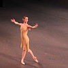 "Maria Kowroski, Dances at a Gathering, January 24, 2014 <br><br> Friday's New York City Ballet theme was Balanchine and Robbins: Masters at Work with two one-hour pieces, Robbin's Dances at a Gathering and Balanchine's Union Jack. <br><br> Dances at a Gathering, set to 18 Chopin piano pieces, premiered in 1969. It marked Robbins's return to New York City Ballet after a 13-year absence in which he choreographed many successful Broadway musicals. Before the premier, <a href=""http://www.pnb.org/AboutPNB/Repertory/DancesGathering.aspx"">Robbins said:</a> ""I'm doing a fairly classical ballet to very old fashioned and romantic music, but there is a point to it. In a way it is a revolt from the faddism today. I find myself feeling just what is the matter with connecting, what's the matter with love, what's the matter with celebrating positive things?"" <br><br> This plotless piece features five couples. The ballet has a light, irreverent tone that doesn't take itself too seriously. The steps are basic throughout with an array of combinations to keep things interesting: several solos, duets with various combinations, guys dancing together, women dancing together as dancers come and go throughout the piece. It's informal as if the dancers spontaneously gather as if to say, ""Hey, here I am, let's dance!"" In one segment, the guys stand in an informal pose, arms on each other's shoulders after a combination, watching what the women can do in their segment. The piece has a number of mazurka steps with exaggerated upper-body movements, a nod to the mazurkas of Chopin's Polish homeland. <br><br> Joaquin De Luz was the dancer in brown (dancers are identified by the color of their costumes in this piece). Joaquin has always been one of my favorites, dating back to his ABT days. I like his athletic style, with powerful pirouettes and leaps, but yet done effortlessly. (One of my favorite Joaquin moments was in Harald Lander's Etudes at ABT, where he ripped off about eight consecutive double tours.) He had several solos throughout the piece and nailed his turns and assemblé en tournant, all with a whimsical demeanor. He also had a duet with frequent partner Megan Fairchild as they exchanged playful glances. Megan's solos demonstrated very precise footwork to the brisk pace. <br><br> I also liked Maria Kowroski as the girl in green. Her solos had an academic, pedantic flavor as if Robbins was trying to show off basic ballet steps such as tendus and the various positions. If so, Maria was perfectly cast, with her long line, legs, and greatly arched feet. Tiler Peck was the girl in pink that featured her substantial playful energy. <br><br> At the end of the piece, all ten dancers were on stage in a circle as if searching for something as the curtain fell. <br><br> Balanchine created Union Jack in 1976 to honor the British heritage of the U.S. during the Bicentennial. According to the program notes, ""Part I is based on Scottish military tattoos and folk dance forms performed in an open castle square."" Part II is a pas de deux for the costermonger Pearly King and Queen of London. Part III consists of dances, songs, and drill orders of the Royal Navy. Hershy Kay provided the score; he also composed the score for Western Symphony and Stars and Stripes, inspired by Sousa marches. <br><br> Part I is dramatic as seven Scottish and Canadian Guard regiments, dressed in kilts with ten members each, slowly and solemnly enter the stage to a loud and steady drumbeat. Part I is based on the Scottish tattoo, which is a military drum performance or army display with members in full regalia. I had a great overhead vantage point Friday evening, sitting in the second row extreme side and could see the patterns that the seven regiments (consisting of 70 dancers) made once they filled the stage with multicolor regalia. (The seats are cheap at only $26-not bad considering that a movie ticket in Manhattan costs $15. The seats aren't terrible, but I could only see about 70%-80% of the stage). From my nice overhead perch, the 70 members were nicely in synch throughout and spaced well over the entire stage, not an easy task with so many dancers. <br><br> Once all seven regiments entered, the mood lightened as each regiment danced. Andrew Veyette was impressive as the Dress MacLeod leader. Sara Mearns handled her duty well as the MacDonald of Sleat leader, clad in white pointe shoes and red and black kilt. It must be difficult to dance in full gear, which may have caused Sara to slip during her regiment's dance. She quickly recovered to lead the troops and complete the high kicking, exciting dance. <br><br> I don't really understand Part 2, which depicts a husband and wife costermonger dance. Costermongers are London street sellers of fruit and vegetables. Amar Ramasar was the Pearly King and Jenifer Ringer the Pearly Queen. It was danced well, but I'm not sure how this part relates to parts one and three; but it did give the dancers time to change into sailor suits for part three. <br><br> Part 3 is ""Royal Navy,"" which features dancers in sailor-clad costumes in a series of rousing, jovial, and energetic dances. Teresa Reichlen was the star, leading the Wrens (Women's Royal Naval Service). Her work featured deep plies in second, long developes with salutes during her pirouettes. The fun comes to an end as the dancers use semaphore flags (flags used to convey information at sea, still used today) to signal ""God Save the Queen"" to the music of ""Rule Britannia"" as the Union Jack is dropped. <br><br><a href=""http://www.nytimes.com/2006/02/12/arts/dance/12tobi.html?pagewanted=all"">Tobi Tobias</a> provides a nice background to the piece: <br><br> """"Union Jack"" was clearly the project of Lincoln Kirstein, the man who, recognizing Balanchine's genius, lured him to the United States in 1933 and fostered his career for the next half-century. The quirky pretext for the ballet was to make a Bicentennial offering to the kingdom from which America had wrested its independence. Kirstein was a self-confessed Anglophile, a condition related to his love of tradition, with its panoply, hierarchy and ritual. In a widely quoted program note, he presented his argument for the ballet in his inimitable prose style: ""In the tepid euphoria of quasi-official celebration, dimmed by an exhausted peace and clownish public scandal"" — a reference to Watergate — ""it has been deemed fitting to recall roots."" In the course of the ballet's making, its tone shifted, so the homage became alternately serious and tongue in cheek."""