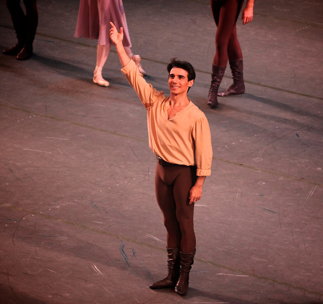 """Joaquin De Luz, Dances at a Gathering, January 24, 2014 <br><br> Friday's New York City Ballet theme was Balanchine and Robbins: Masters at Work with two one-hour pieces, Robbin's Dances at a Gathering and Balanchine's Union Jack. <br><br> Dances at a Gathering, set to 18 Chopin piano pieces, premiered in 1969. It marked Robbins's return to New York City Ballet after a 13-year absence in which he choreographed many successful Broadway musicals. Before the premier, <a href=""""http://www.pnb.org/AboutPNB/Repertory/DancesGathering.aspx"""">Robbins said:</a> """"I'm doing a fairly classical ballet to very old fashioned and romantic music, but there is a point to it. In a way it is a revolt from the faddism today. I find myself feeling just what is the matter with connecting, what's the matter with love, what's the matter with celebrating positive things?"""" <br><br> This plotless piece features five couples. The ballet has a light, irreverent tone that doesn't take itself too seriously. The steps are basic throughout with an array of combinations to keep things interesting: several solos, duets with various combinations, guys dancing together, women dancing together as dancers come and go throughout the piece. It's informal as if the dancers spontaneously gather as if to say, """"Hey, here I am, let's dance!"""" In one segment, the guys stand in an informal pose, arms on each other's shoulders after a combination, watching what the women can do in their segment. The piece has a number of mazurka steps with exaggerated upper-body movements, a nod to the mazurkas of Chopin's Polish homeland. <br><br> Joaquin De Luz was the dancer in brown (dancers are identified by the color of their costumes in this piece). Joaquin has always been one of my favorites, dating back to his ABT days. I like his athletic style, with powerful pirouettes and leaps, but yet done effortlessly. (One of my favorite Joaquin moments was in Harald Lander's Etudes at ABT, where he ripped off about eight consecutive do"""