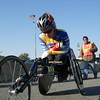 Edith Hunkeler of Switzerland, winner in 2005, tries to stay warm before the start of the 2007 New York Marathon wheelchair race. Hunkeler won the race in a course record 1:52:38.