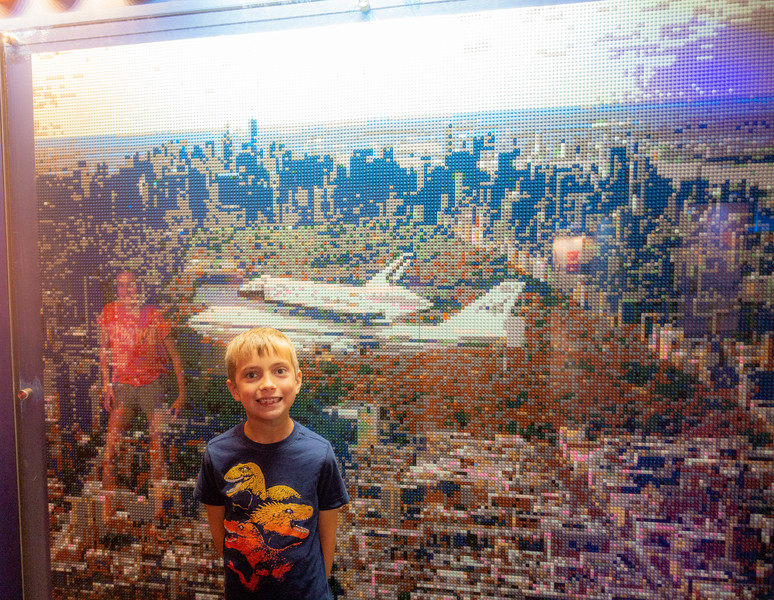 Will in front of a LEGO mural