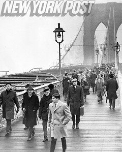 NYC Transit strike causes commuters to use the city's many bridges on foot. This is the scene on the Brooklyn Bridge this wintry day in 1966