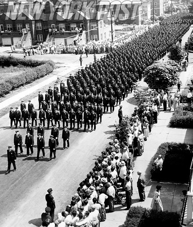 A funeral procession for a NYC policeman on Rhinelander Ave in the Bronx. 1950