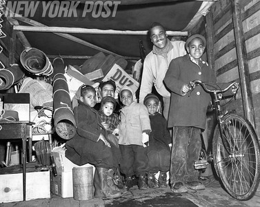 Benjamin Careathers, Vivienne and his five children into the truck that moved their furniture from Jamaica Bay Houses. 1948
