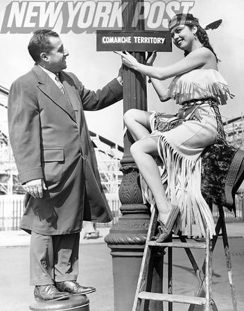 Jeanna Carmen Puts Sign on Post With Thomas H. Tesaurao.