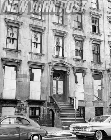 Close up of boarded brownstones between court and Clinton Streets. 1962