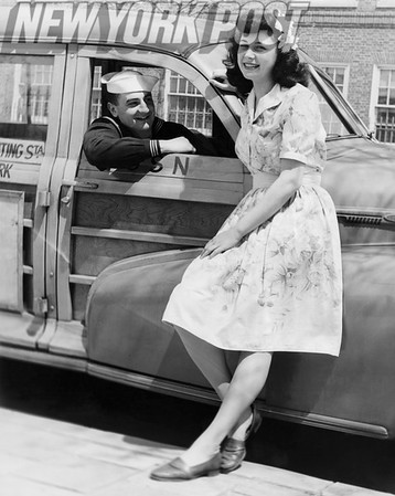 "Pin-Up Girl Poses Next to First-Class Seaman in his Classic ""Woodie"" Station Wagon."