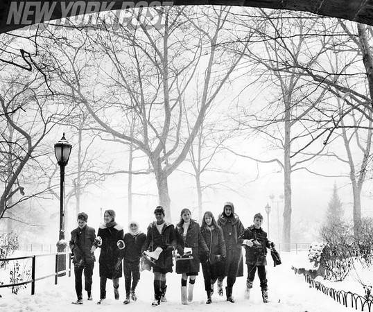 Teens enjoy the snowy conditions in Central Park, NYC. 1964