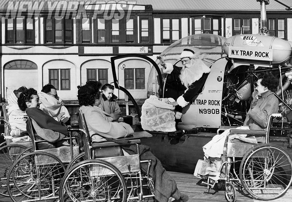 Hospital Patients say goodbye to Santa as he takes off in a helicopter. 1955