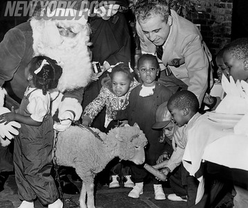 Children enjoy a local Christmas Garden with Santa. 1965