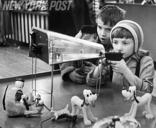 Children test out the latest arcade games in a New York toy store. 1956