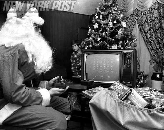 Santa Takes Time Out To Play Atari Space Invaders. 1980