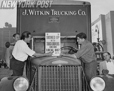 Teamsters place Union sign on a delivery truck. 1946