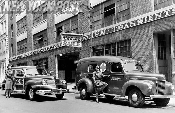 Red Cross workers with their new Chrysler and International ambulances. 1943