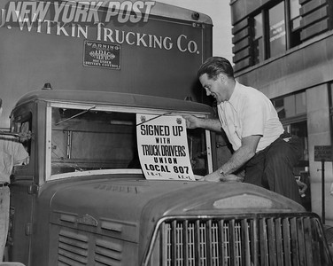 Jimmy Martin affixes sign to truck announcing he is now a Union member. 1946