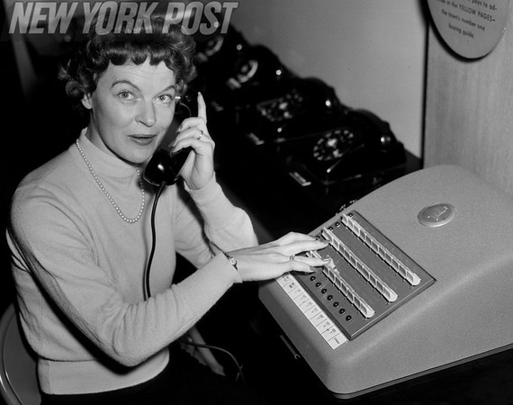 Telephone switchboard operator answers and redirects a call. 1954